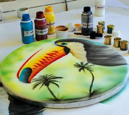overview and basic exercises through illustration on fondant to complete Holiday and Wildlife design cakes.