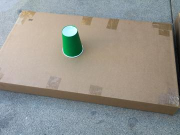 The two halves of the box are laid end to end for a longer green. You may need to cut, fold, and join parts to construct a similar green, depending on your materials.