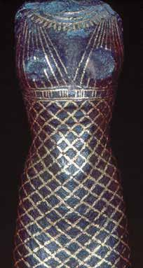 Fig. 9. Inlaid, head- and armless statuette in the Louvre, Inv. E27430, stylistically dated to 1075 664 BCE or 1994 1650 BCE, representing a woman wearing a gold embroidered clinging dress.