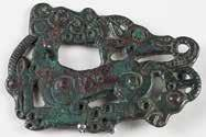 Garment ornament with crouching carnivore savaging the head of an herbivore. Bronze.