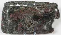 Openwork hook buckle with crouching tiger and three gazelle heads. Tinned bronze.