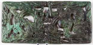 242. Buckle plaque with dragon and felines. Bronze. 2 nd century BCE.