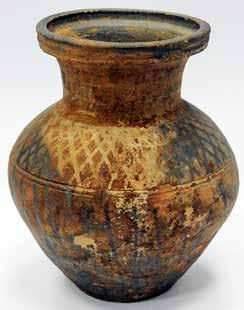 2 cm thick, with a cylindrical nail down through the middle to attach them to the wood [Figs. 11]. Ceramic.