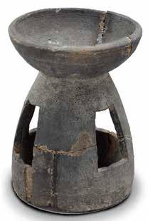 Lamp from Tomb M2 a total of 12 pieces; M6 has only one piece. There are three types: pots, jars, and lamps. The jar found in M3 has an everted mouth, a long neck, and a small flat base.