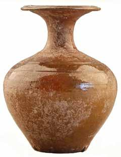 Fig. 18. Glazed ceramic jar from Tomb M1. Fig. 19. Glazed ceramic pot from Tomb M1. is 10.1 cm high [Fig. 18].