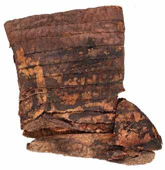 These felt boots [Fig. 38], found in Tomb M3, are high with a pointed tip. They are 26.5 cm long and 19.5 cm high.