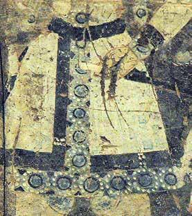Analogous pearl roundel imagery with the boar s head decorates the garment of one of the donor figures normally considered to be Tocharians or Sogdians in a mural from Cave No.
