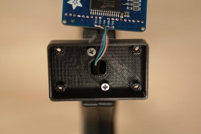 Secure LED Enclosure to Handle Postion the dhp-led.stl part over the top of the handle and line up the mounting holes.