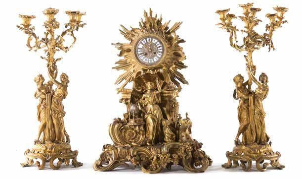 swastika and diamond decoration, 9 in H Est $1500-2000 1293 Continental onyx and gilt-metal clock garniture second half-19th century; portico clock with four columnar supports, enamel face on shaped