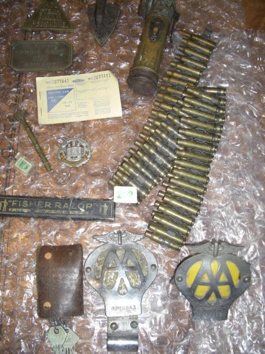 badges, ammunition belt, mini iron, old torch, rally