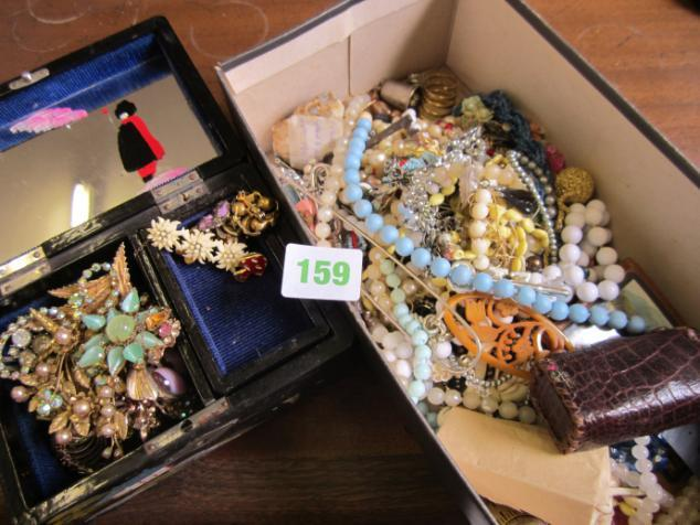 containing assorted brooches, plus badges