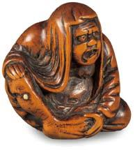 5 cm) a self-mocking joke by the Asakusa master carver,