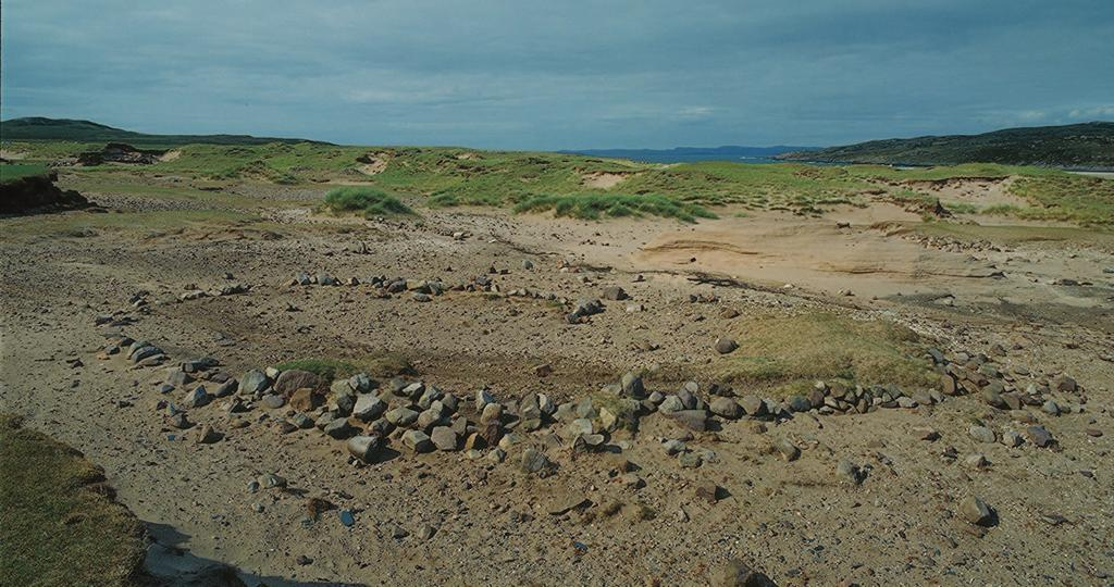 Coastal erosion is a huge problem in Scotland, not just by the sea but also by the wind. Here the rubble footings of an oblong house have been exposed as the wind has blown away the sand dunes.
