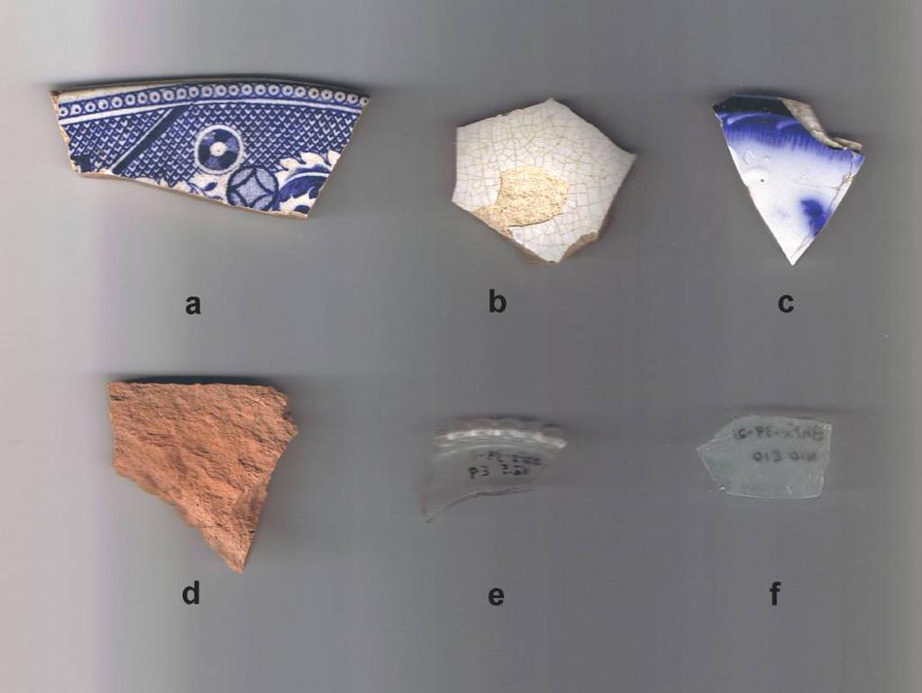 Plate 9: Selected Stage 2 Artifacts from Gourley Site (BhFx-39) a, blue transfer platter rim, BhFx-39-10, N5E72 b, refined white earthenware vessel side, BhFx-39-9, N5E9 c, flow blue plate rim,