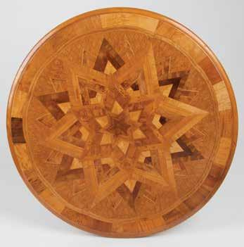 The top with inlaid geometric starburst pattern in multiple NZ timbers with background diamond form