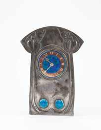 height $4,000-6,000 908 David Vessey For Liberty & Co, Cymric S/S & Enamel Mantel Clock dial marked Tempus Fugit with stylised tree above in