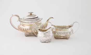 floral top scroll feet, London 1820 & 1822 $1,200-1,600 932 Fine & Large Early Vict S/S Spirit Kettle the fixed handle with carytid supports, domed lid with melon and leaf cast finial, bird form