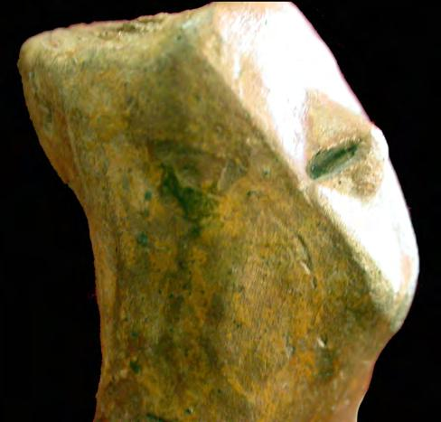 The above presented figurine was covered with red ochre and then with yellow ochre, which is very clear on the mask. The mask is 3.2 cm high and 3.0 cm large at the top.