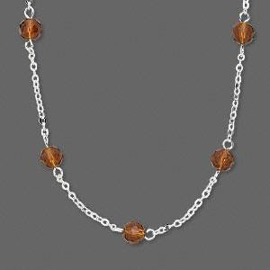 Necklace, silver -plated brass chain with 6mm brown faceted glass rounds. Sold per 16-inch necklace with 2-inch 2 extender chain.