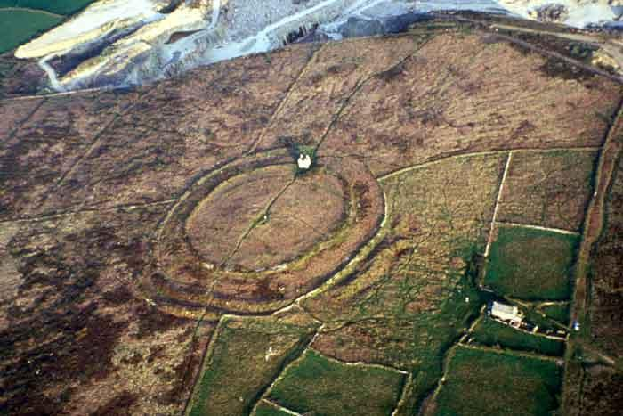 Castle an Dinas, West Penwith. Faint traces of a circular banked enclosure lie inside the circuit of innermost rampart of the Iron Age hillfort.
