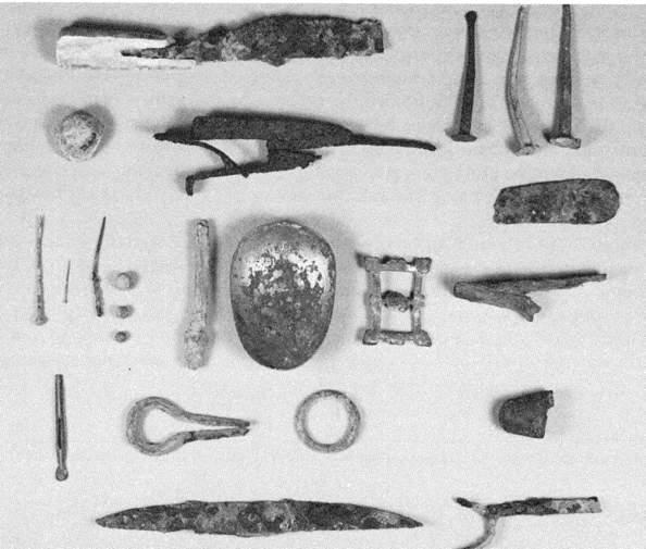 Bottom row: 1 and 5 Indian projectile points, 2 and 4 Indian stone Scraper's, 3. Scraper fashioned from wine bottle fragment. Figure 22. Top row: l.