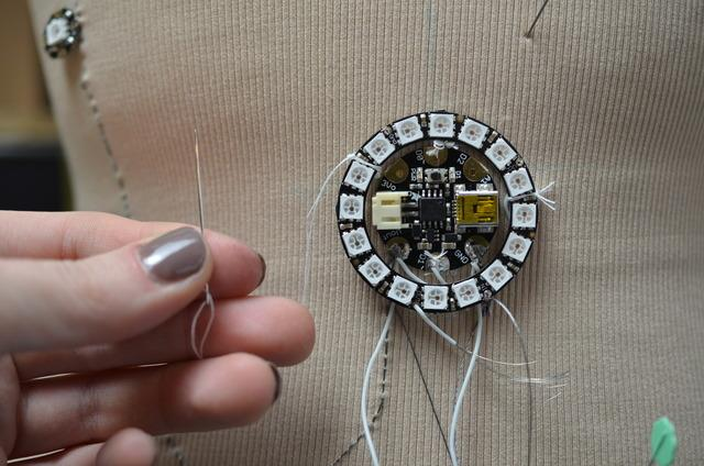 Secure the NeoPixel ring to the garment with plain thread.