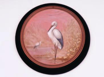 A Watcombe pottery plaque of circular form with beaded and moulded border, the centre finely enamelled by Alexander Fisher with a pair of Herons in a waterside landscape, A.