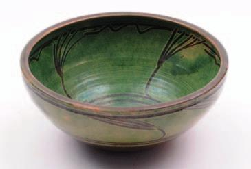 595. Michael Cardew (1901-1983), an earthenware bowl decorated with simple finger trailed designs in green slip over brown, 31 cm diameter, impressed personal and Winchcombe pottery seals. 280-320.