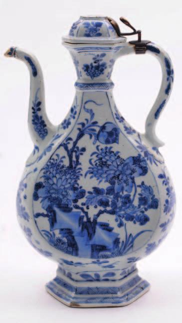 541. A Chinese porcelain wine ewer of flattened hexagonal Persian form with single neck ring, slender handle and spout with domed cover and metal mounts painted in blue with peony and verso