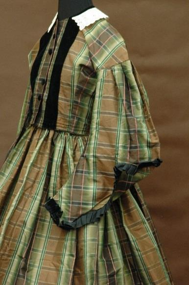 MHCTC s exhibition showcased a variety of plaids in the Collection s holdings, including a 19 th century silk plaid dress pictured to the left (Gift of the Faurot Family) and a 2007 wool tartan kilt