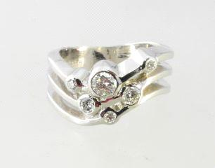 white gold and diamond heart shaped ring. 14k white gold bridal set with 0.42k diamond.