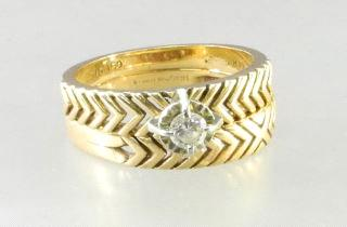 $500 - $750 492 493 14kt. gold and diamond engagement ring with matching wedding band.