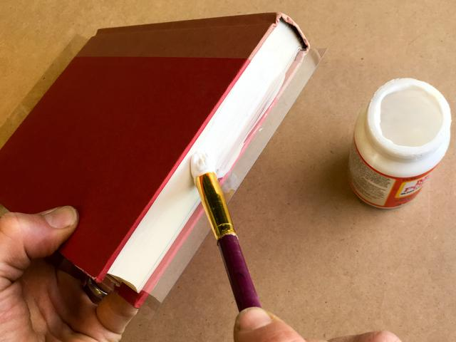 There's no need to put glue in between each page -- the glue will soak in
