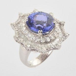 98 18K GOLD, TANZANITE AND DIAMONDS 18K white gold ring set with a natural tanzanite weighing approximately 10ct and measuring 12.65x8.