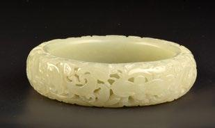 124 CHINA, QING DYNASTY, CIRCA 1900 Celadon jade bangle, decorated with an openwork of flowers and foliage. China, around 1900.