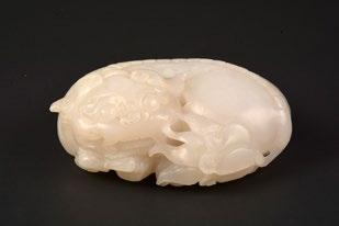 5 126 CHINA 20th C. White sculpted jade twist bangle. China, 20th C. D: 7.5cm - 3 Inside D: 6cm - 2.