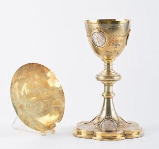 32 Silver and metal chalice resting on a poly-lobed base deocrated with a toupie foot and a floral decor with six medallions depicting biblical scenes.