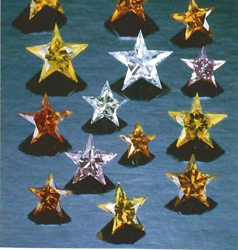 Although we have seen some successful attempts to cut and facet diamonds into five-pointed stars, we were impressed with the briili,mcy and consistency of worlunanship in the fashioned stones offered