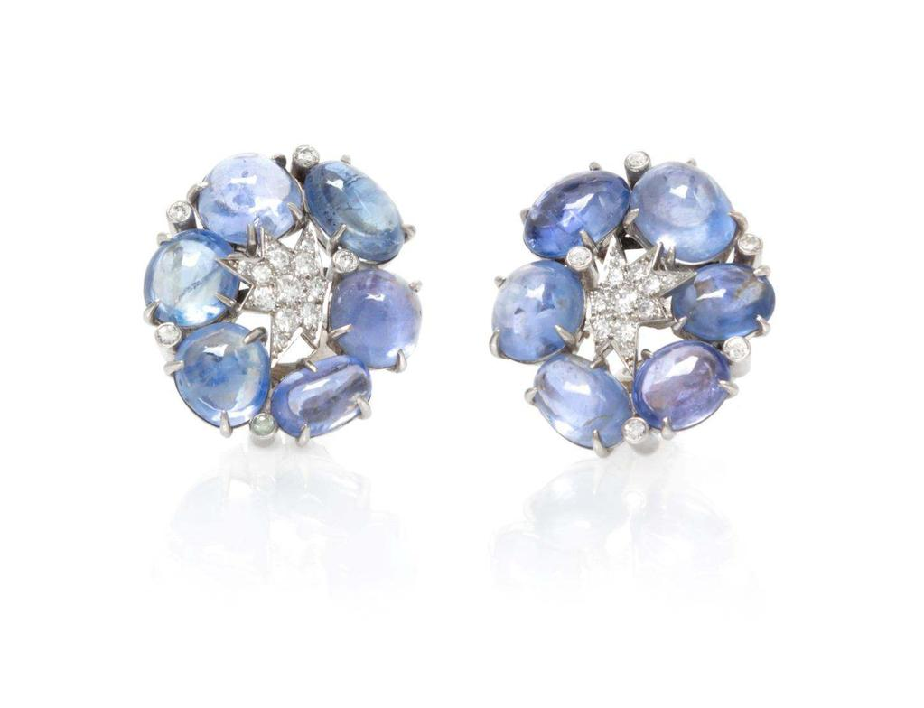 Sale 394 Lot 120 A Pair of Platinum, Diamond and Sapphire Star Earclips, Verdura, Circa 1945, consisting of central star motif plaques and scattered bezel settings containing 30 round brilliant cut