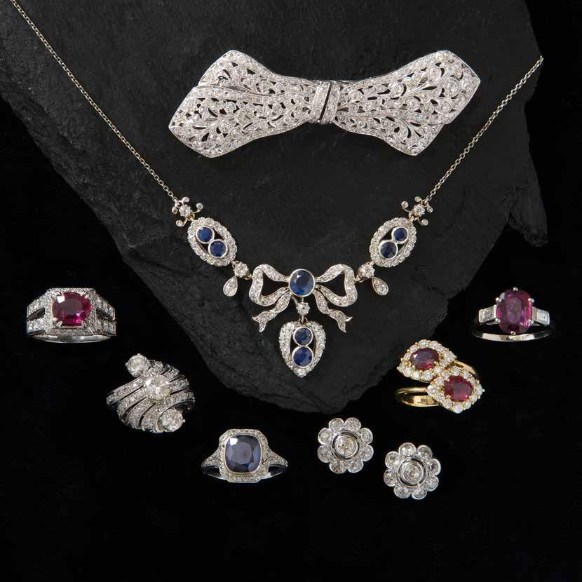 Diamond bow double clip brooch circa 1925 Sapphire & diamond necklace circa 1920 Ruby ring with diamond shoulders estimated ruby weight = 2.