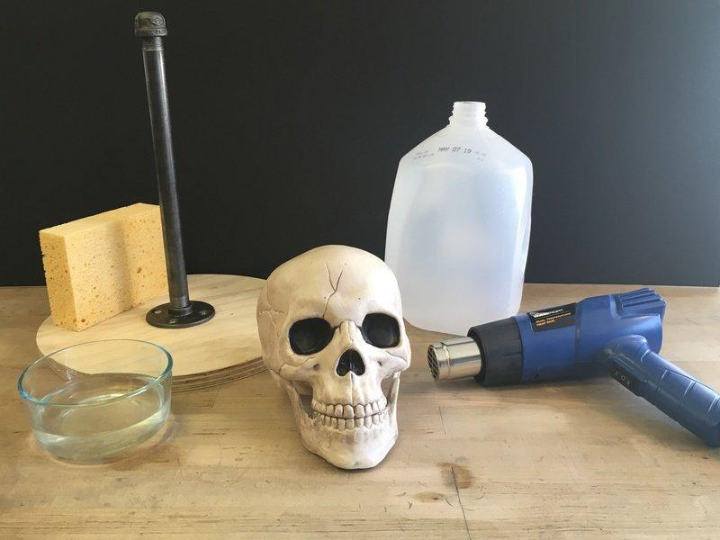 Materials & Tools In addition to the above parts, you'll also need these materials and tools: Decorative skull made of thick plastic (too thin and it won't resist the heat, and thus melt) One gallon
