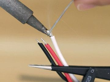 Use the 22 gauge setting on the wire stripper and remove the ends of the the ground (black), power (red) and data (white).