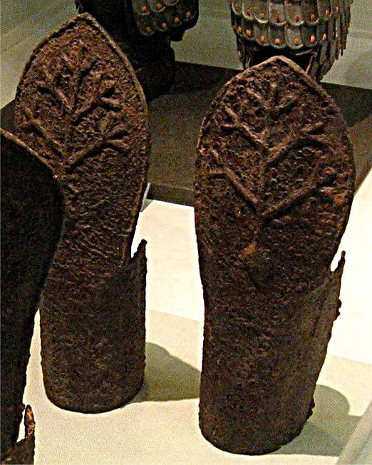 vambraces to the left are of similar construction to the greaves, but have longer enclosure to go around the forearm.
