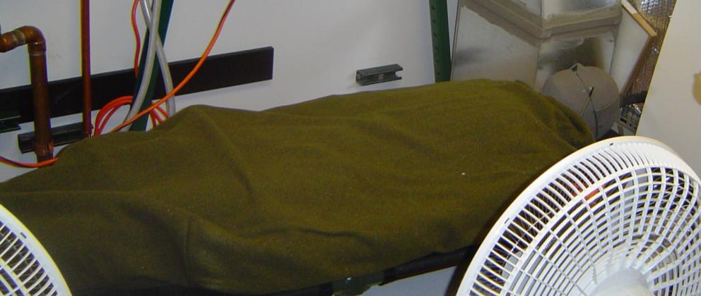 The chemical heating blanket system consisted of a sheet next to the patient, a thin blanket containing the chemical, and an outer radiation shield.