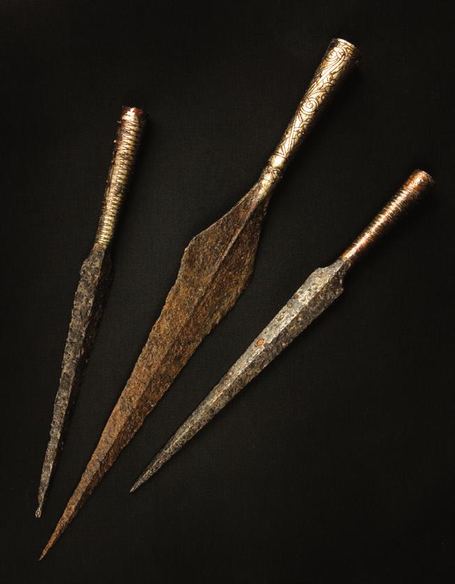 A 7th-century Viking helmet. Upper: Weapons were also works of art, such as these 7th-century spearheads with intricate patterns.
