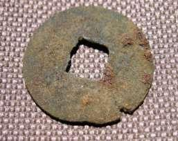 Figure 17 Chinese coin With the new information collected from the Opium Cabin site with the help of our 2014 Passport In Time crew we can begin to speculate on the function of the site and how it