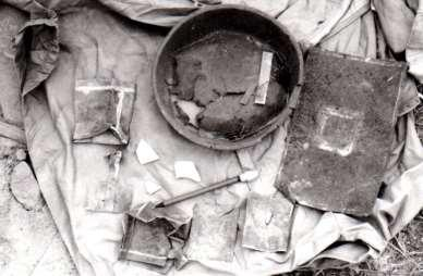 Figure 8 surface artifacts documented in 1984 including opium cans and solder patched metal, photo from 1984 site record.