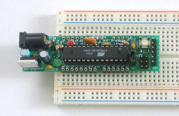 Insert them into a solderless breadboard as shown so that the long legs are in the solderless