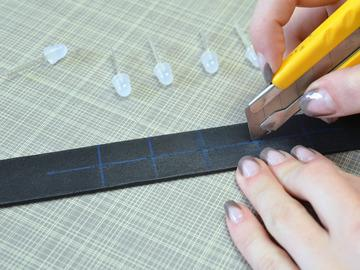 Use a utility knife to cut small horizontal slits in the collar at