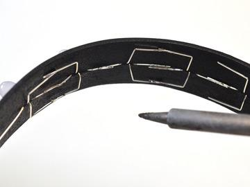 Solder overlapping wire leads while the collar is curved, using a pair